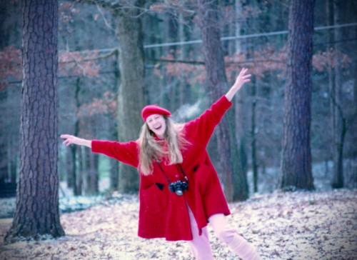 Sharlene Holt with Camera, Red Coat and Hat circa 1985