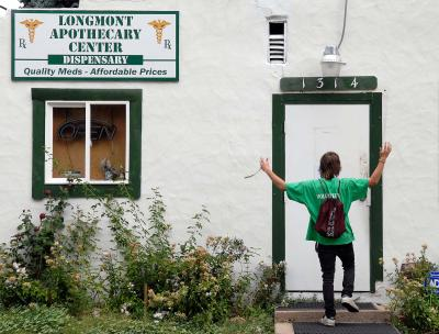 "Eric Dugwyler of Longmont exclaims ""Nooooo!"" as he discovers that the Longmont Apothecary dispensary is closed on Friday afternoon, Aug. 19"