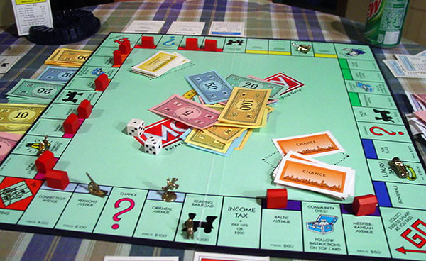A Monopoly Game: Are Americans the Players or are we the Property?