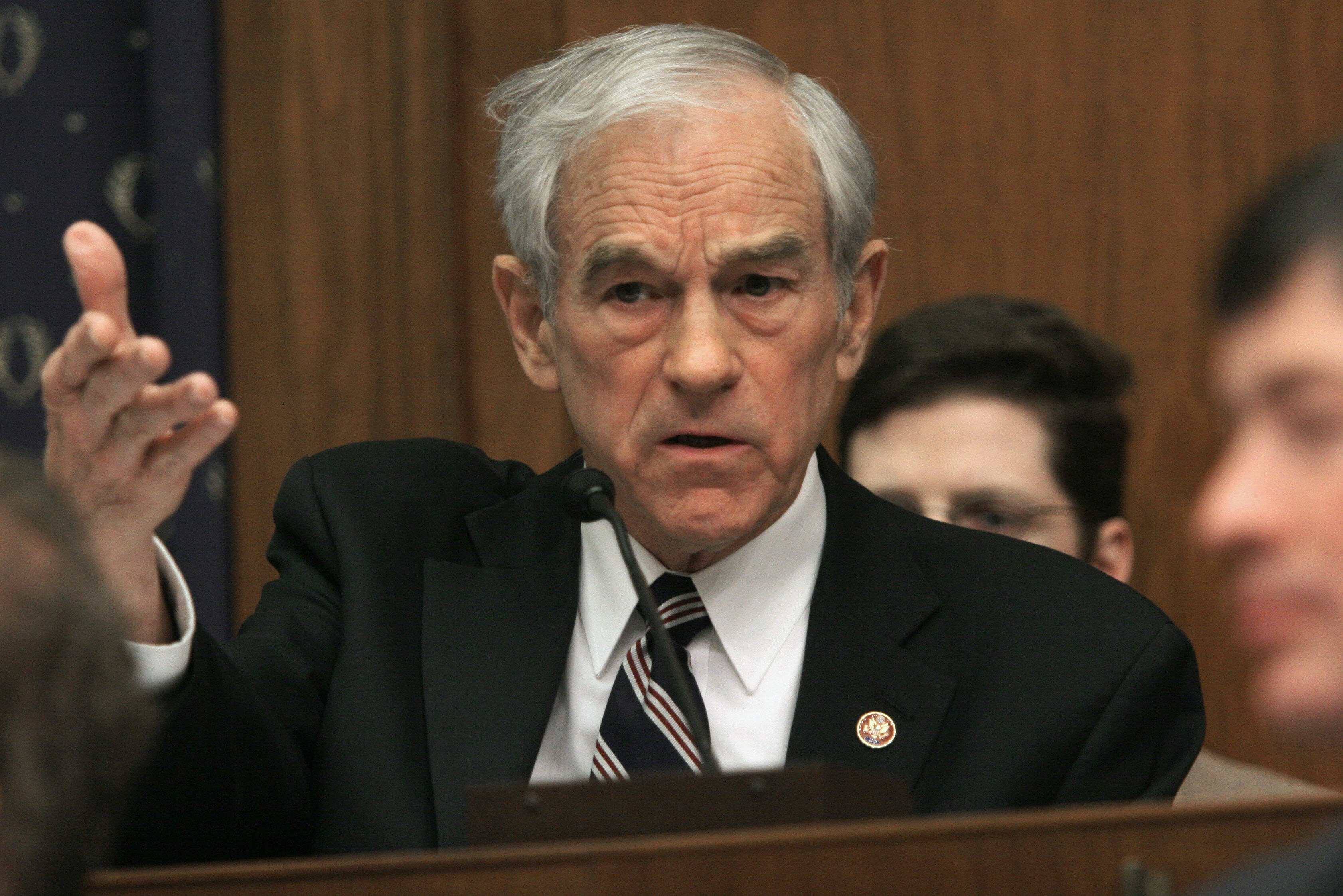 US Republican Representative from Texas and presidential hopeful Ron Paul questions Federal Reserve chairman Ben Bernanke during a hearing on the economy