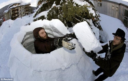 Protestors build an igloo in Davos
