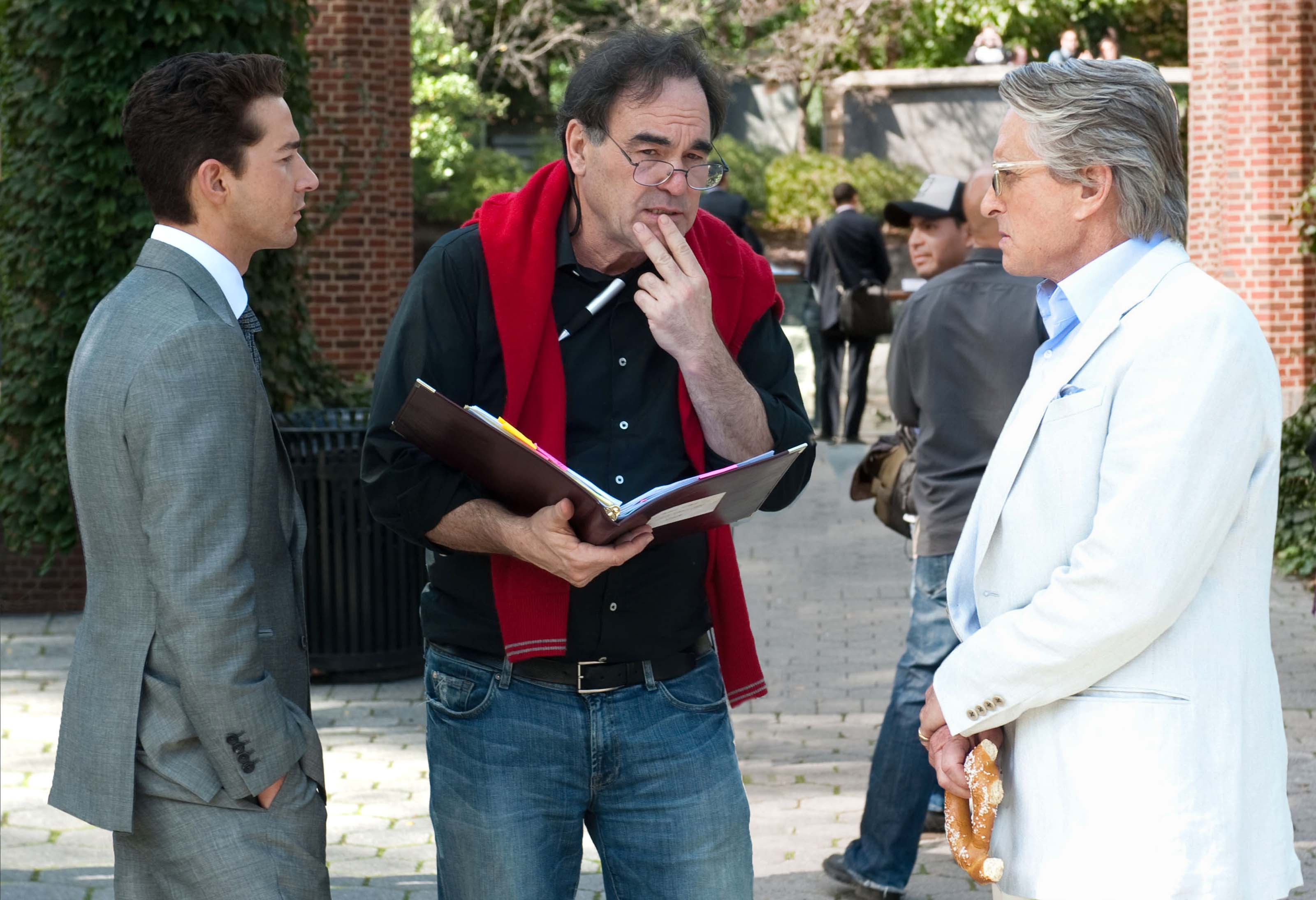 Oliver Stone (middle) would vote for Ron Paul over Obama