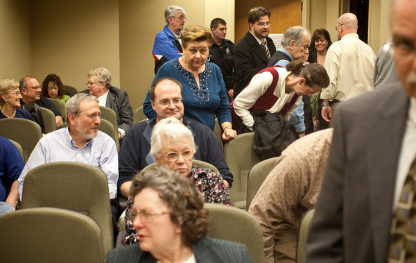 Jared Soares for The New York Times At a Roanoke County, Va., meeting, dozens opposed the county's paying $1,200 to a nonprofit.