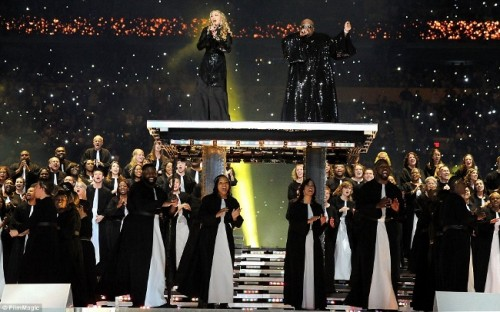 Madonna, raised above the rest of the people