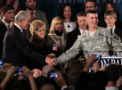 Ron Paul (R-TX) (L) shakes hands with U.S. Army Corp. Jesse Thorsen (R)