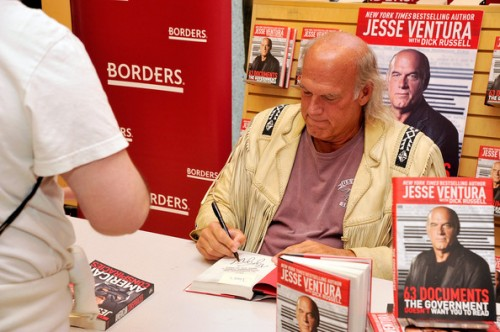 Jesse Ventura signs his book 63 Documents the Govt. Doesn't Want You to Read