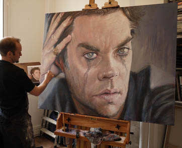 Derren Brown painting a portrait of Rufus Wainwright