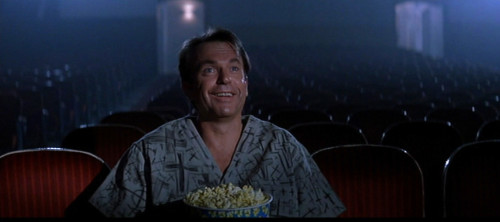 Sam Neill enjoying the show in John Carpenter's film, In the Mouth of Madness