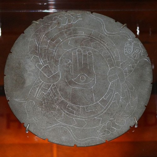 The Rattlesnake Disk. A ceremonial stone palette plowed up by a 19th century farmer in Moundville, Hale County, Alabama