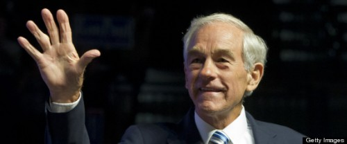 US Republican presidential contender Ron Paul greets his supporters as he arrives on the stage at the Sun Dome at the University of South Florida in Tampa , Florida, on August 26, 2012.