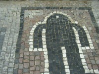 Golem mosaic in the streets of Prague