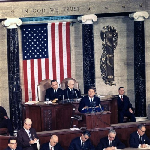 JFK speaks in front of the U.S. military flag and Roman fasces, which adorn the sides of his speaker's podium. Birch Rods were used as a means of punishing prisoners in 1899.