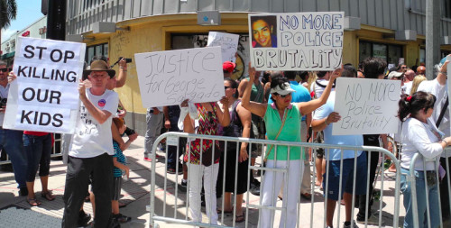 A vigil on Aug. 10 in Miami Beach for Israel Hernandez-Llach, who died after being shocked with a Taser.