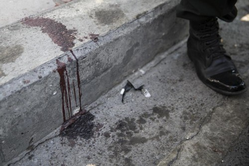 Blood splattered on curb in Thailand: Who's blood is it? This is a job for Dexter! Oh wait - he's not on the job anymore....