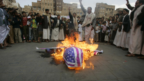 Protesters loyal to the Shi'ite al-Houthi rebel group burn an effigy of a U.S. aircraft during a demonstration to protest against what they say is U.S. interference in Yemen, including drone strikes