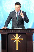 Tom Cruise making a Scientology presentation.