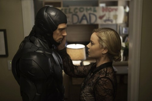 """Robocop (2014) """"Fallen"""" Adam and Eve: The Perfect New World Order Couple! She votes, He dies."""