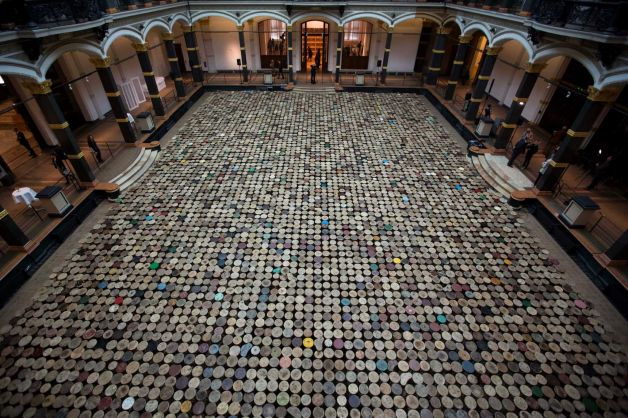 The artwork 'Stools' by Chinese artist Ai Weiwei is displayed in the atrium of the Martin-Gropius-Bau Museum at the exhibition 'Evidence' in Berlin, Wednesday, April 2, 2014.