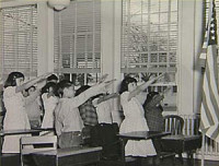 American students extending the arms toward the flag, Nazi-style.
