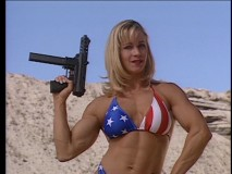 Scene from QT's Jackie Brown: Chicks who love guns wear bikinis!