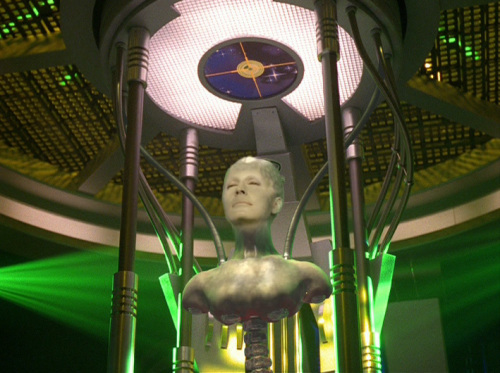 "The Borg Queen descends from the Central Alcove: ""We too are on a quest to better ourselves."""