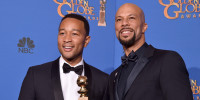 Recording artists John Legend (L) and Common, winners of Best Original Song - Motion Picture for 'Glory' (from 'Selma'), pose in the press room during the 72nd Annual Golden Globe Awards.