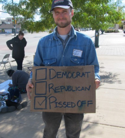 Ben Gilmore Holds a Sign in Fort Collins
