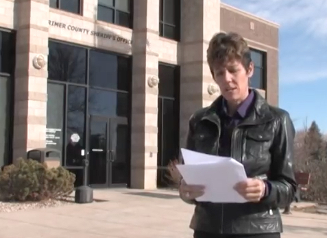 Investigative Journalist Stacy Lynne in Front of the Larimer County Courthouse