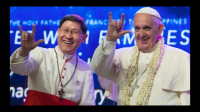 The Pope Throws Up the Devil Horns