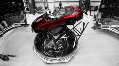 Elon Musk's Cherry Red Tesla Roadster Getting Ready to Fly with Spaceman